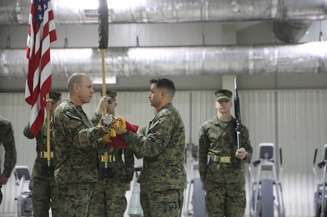 Sgt. Maj. Brian Alsleben, left, sergeant major of 1st Battalion, 8th Marines uncases the colors alongside Lt. Col. Justin Ansel, right, commanding officer of 1st Battalion, 8th Marines during the transfer of authority ceremony aboard Mihail Kognalniceanu Air Base, Romania, Jan. 22, 2016. The rotational force of Marines and sailors gives U.S. European Command the continuous capability to integrate with NATO and partner nations in Eastern Europe. (U.S. Marine Corps photo by Cpl. Immanuel M. Johnson/Released)