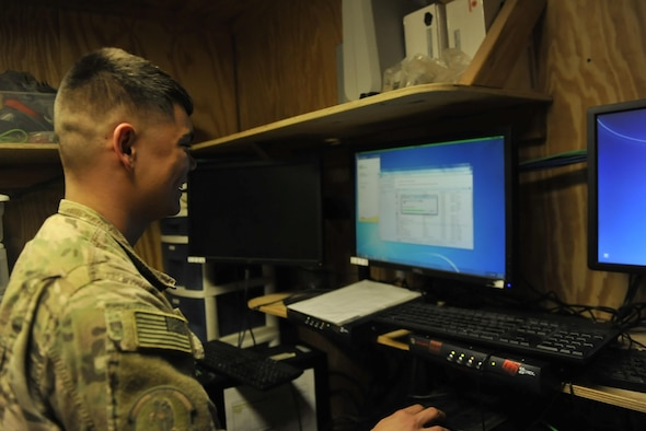 Senior Airman Andrew Dawson, 455th Expeditionary Communications Squadron Client Systems technician, updates a computer system before it is return to the cyber network at Bagram Airfield, Afghanistan, on Jan. 13, 2016. The 455th Network Operations and Client Systems sections have the critical responsibility of ensuring that the systems required for command and control, accountability, and more are functioning properly and are adequately protected from cyber threats. (U.S. Air Force photo by Tech. Sgt. Nicholas Rau)