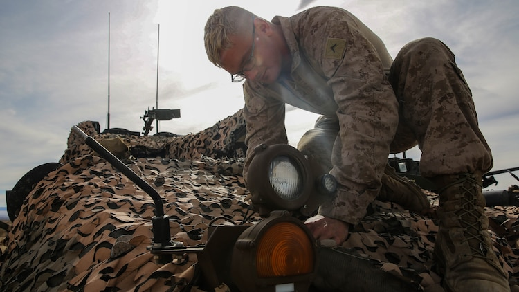 Pfc. Merrick Martius, a Light Armored Vehicle crewman, provides maintenance for an infrared light on an LAV-25 during a live-fire gunnery qualification test at Marine Corps Air Ground Combat Center Twentynine Palms,California, Jan. 22, 2016. The qualification test consisted of gunnery training, communication between the vehicle commander and the driver, and cooperation between the crewmembers of the LAV and the command tower. This allows Marines to fire accurately when aiming on targets down range. Martius is an LAV crewman with Headquarters and Service Company, 1st Marine Division, I Marine Expeditionary Force.
