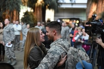 Senior Airman Christopher Gonzales, of the 144th Security Forces Squadron, is welcomed home by Megan Woodby at the Fresno Yosemite International Airport, Calif., Jan. 21, 2016. Gonzales was deployed for more than seven months in support of Operation Freedom's Sentinel. (U.S. Air National Guard photo/Senior Master Sgt. Chris Drudge)