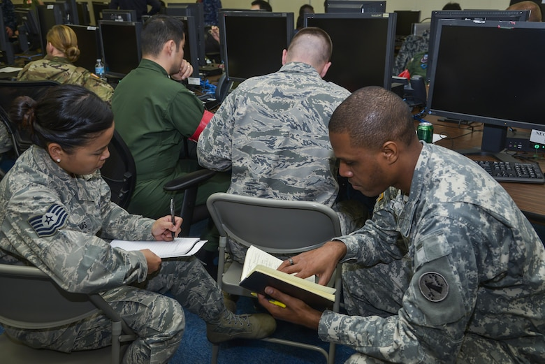 Japan Self-Defense Force and U.S. military members work on a scenario during exercise Keen Edge 16 at Yokota Air Base, Japan, Jan. 21, 2016. The exercise focused on bilateral coordination, force protection, host nation support, ballistic missile defense and non-combatant evacuation operations in Japan. (U.S. Air Force photo/Senior Airman David Owsianka)