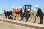Defense Logistics Agency Energy Installation Energy Director Pam Griffith, second from far left, and other stakeholders break ground on the Army's first-ever hybrid solar and wind energy project at Fort Hood, Texas, Jan. 28. DLA Energy supported the Army's renewable energy goals through a contract awarded Jan. 15.