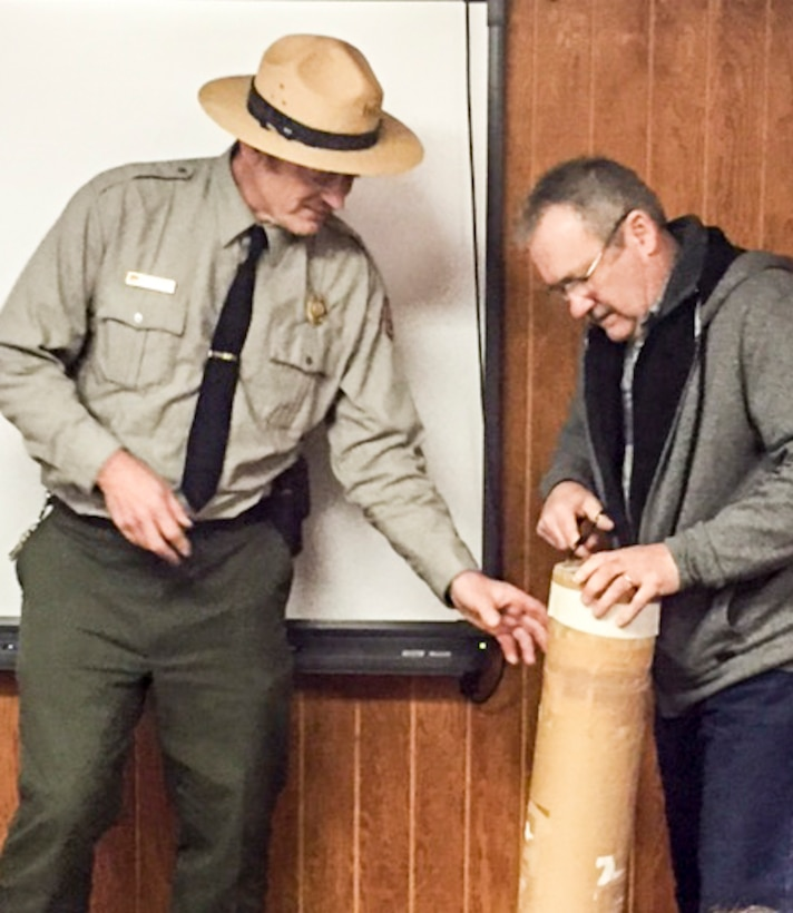 Rodney Daum (left), Tionesta Lake resource manager, and William Alex, a former Tionesta Lake resource manager, opened and inventoried a 1991 time capsule.