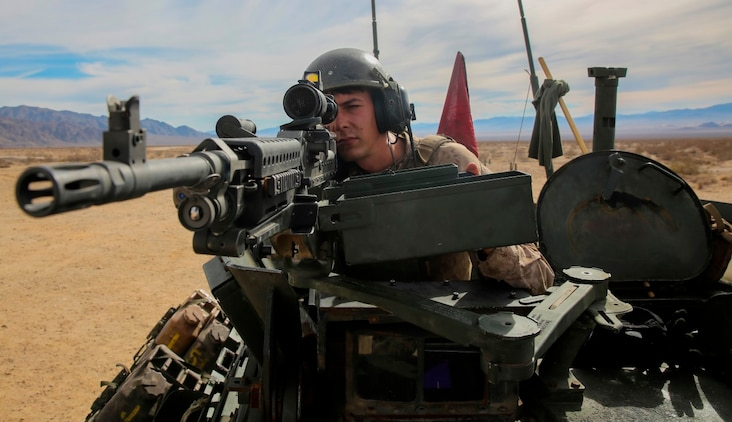 Sgt. Tyler Felts, an LAV crewman, sights in on a target during a live-fire gunnery qualification test with an M240B machine gun at Marine Corps Air Ground Combat Center Twentynine Palms, Jan. 22, 2016. Live-fire tests like these allow the Marines of 1st Light Armored Reconnaissance Battalion, 1st Marine Division, I Marine Expeditionary Force to train for how they will execute their mission when they are deployed in a combat zone. (U.S. Marine Corps photo by Pvt. Robert Bliss)