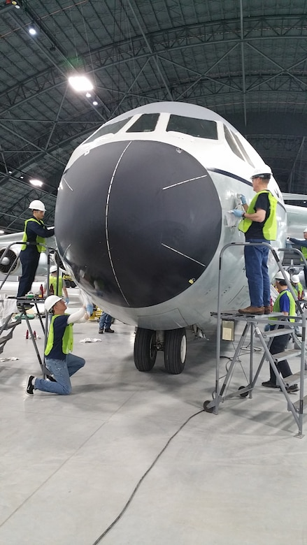 """Volunteers cleaning and polishing the C-141 Starlifter """"Hanoi Taxi"""" on January 28, 2016. The work is being done in preparation for the museum's new fourth building, which opens June 8th."""