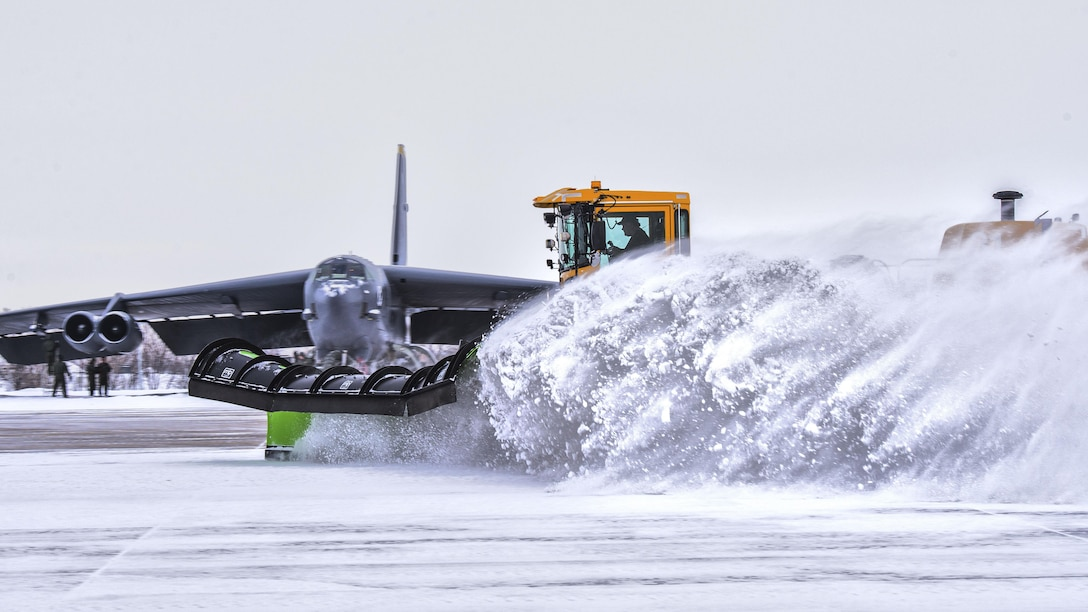 The 5th Civil Engineer Squadron removes snow from the flightline before a training sortie at Minot Air Force Base, N.D., Jan. 14, 2016. Bomber Airmen work around the clock in all weather conditions in order to provide B-52H Stratofortress firepower on demand. (U.S. Air Force photo/Airman 1st Class J.T. Armstrong)