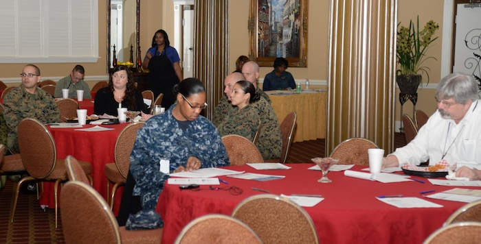 Active-duty service members, their spouses as well as the installation's civilian personnel attend a 'Lunch and Learn' forum, Jan. 28, at Marine Corps Logistics Base Albany's Town and Country Restaurant and Ballroom. Base officials sponsored the event to address questions parents of school-aged children may have as the State rolls out the new 2016 Georgia Milestones Assessment System and testing requirements for the area's students.