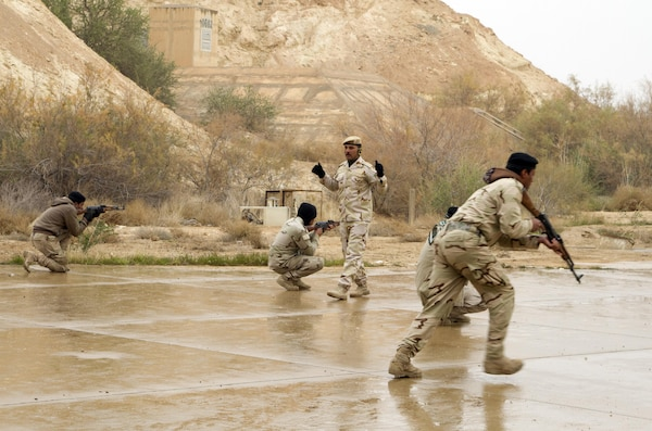 An Iraqi army noncommissioned officer directs Iraqi soldiers during squad movement training at Al Asad Air Base, Iraq, Jan. 15, 2015. Several Iraqi army battalions were training throughout Iraq with the assistance and support of coalition forces. U.S. Army photo by Sgt. William White