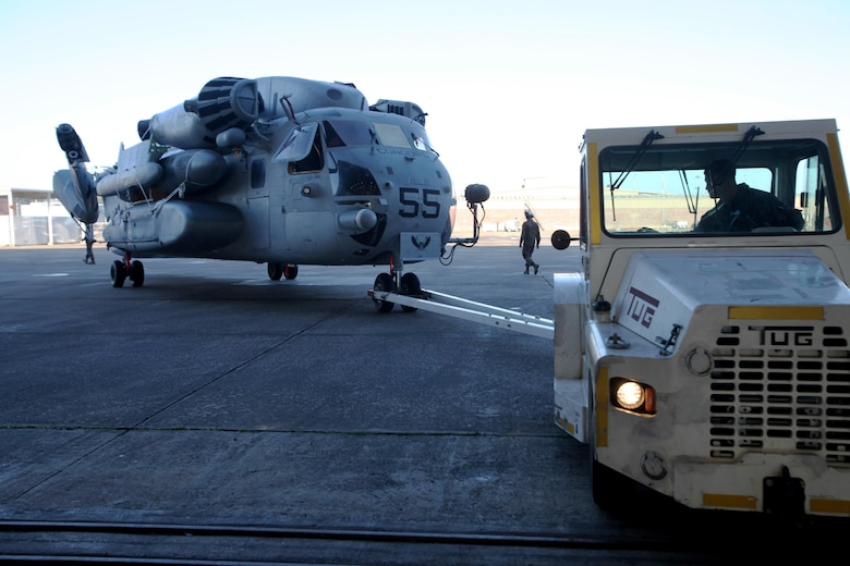 Cpl. Conner Tucker tows a CH-53E Super Stallion during aircraft transportation at Marine Corps Air Station Cherry Point, N.C., Jan. 29, 2016. 63 Marines from Marine Heavy Helicopter Squadron 464 broke down CH-53E Super Stallions and AH-1W Super Cobras for transport to Norway for Exercise Cold Response 2016. Tucker is a flight line mechanic with HMH-464. (U.S. Marine Corps photo by Cpl. Jason Jimenez/Released)