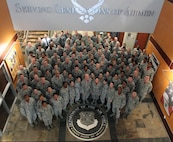 Service members from the Air Reserve Personnel Center have their photo taken after an enlisted call hosted by Chief Master Sgt. Mitchel Brush, senior enlisted leader to Gen. Frank Grass, Chief of the National Guard Bureau, Jan. 29, 2016, on Buckley Air Force Base, Colo. (U.S. Air Force photo/Master Sgt. Richard Grybos)