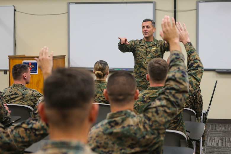 Maj. Gen. Michael Rocco, commanding general of 3rd Marine Aircraft Wing, talks to Marines with Marine Aircraft Group (MAG) 39 Corporals Course 341-16 aboard Marine Corps Base Camp Pendleton, Calif., Jan. 14. Eighty-one Marines graduated the three-week long training course, Jan. 27. (U.S. Marine Corps photo by Lance Cpl. Harley Robinson/Released)