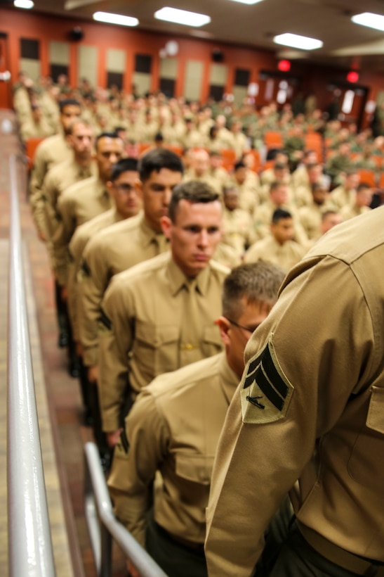 Marines with Marine Aircraft Group 39 (MAG) Corporals Course 341-16 stand in line to receive their certificate during their graduation aboard Marine Corps Base Camp Pendleton, Calif., Jan. 27. Eighty-one Marines graduated the three-week long training course required for corporals to earn the next rank. (U.S. Marine Corps photo by Cpl. Alissa Schuning/Released)