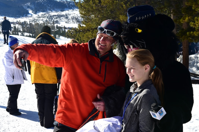 Members of Team Buckley pose for a selfie with Buck Lee, 460th Space Wing mascot, during Snofest Jan. 23, 2016, at Keystone Resort, Colo. Snofest is a military appreciation event at Keystone Resort for the Front Range Military Bases, which includes skiing, snowboarding and many discounts for military members. (U.S. Air Force photo by Airman 1st Class Gabrielle Spradling/Released)