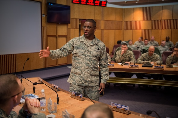 Chief master sergeant selects listen to Chief Master Sgt. James E. Davis, USAFE-AFAFRICA command chief, during a leadership course at Ramstein Air Base, Germany, Jan. 28, 2016. The Chiefs' Leadership Course offers senior level mentoring to the attending chief selects, gaining invaluable command specific perspectives, mission awareness and objectives. (U.S. Air Force photo/ Tech. Sgt. Ryan Crane)