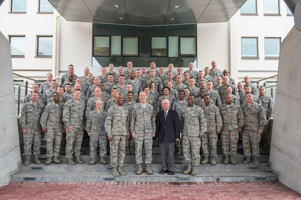 Chief master sergeant selects pose for a photo during a leadership course at Ramstein Air Base, Germany, Jan. 28, 2016. The Chiefs' Leadership Course offers senior level mentoring to the attending chief selects, gaining invaluable command specific perspectives, mission awareness and objectives. (U.S. Air Force photo/ Tech. Sgt. Ryan Crane)
