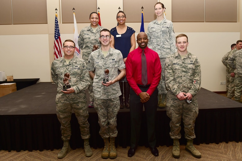 Team Buckley quarterly award winners stand together Jan. 28, 2016, at the Leadership Development Center on Buckley Air Force Base, Colo. The award winners were chosen because of their hard work and dedication in their work centers. (U.S. Air Force photo by Airman 1st Class Gabrielle Spradling/Released)