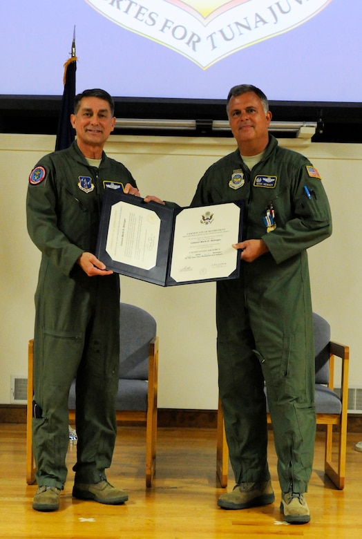 Brig. Gen. Warren H. Hurst, Kentucky's assistant adjutant general for Air, presents the certificate of retirement to Col. Mark Heiniger who officially retired from service during a ceremony held at the 123rd Airlift Wing, Louisville, Kentucky, Nov. 07, 2015. He retires with more than 28 years of service most recently as the State Operations Officer for Joint Force Headquarters Kentucky. (U.S.Air National Guard photo by Tech. Sgt. Vicky Spesard)