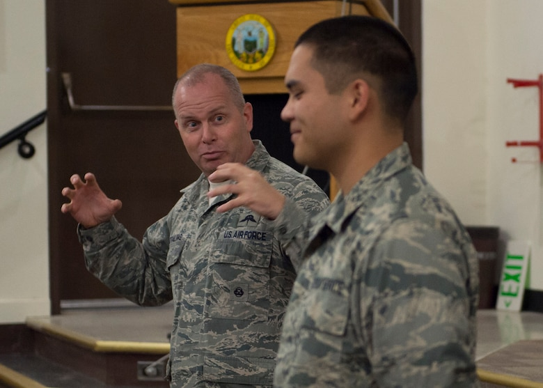 Command Chief Master Sergeant of the Air National Guard James W. Hotaling identified the newest member, Airman Basic Cox assigned to the 124th Fighter Wing Student Flight, and called him to the stage at an enlisted all during his visited the 124th Fighter Wing at Gowen Field, Boise, Idaho, Jan. 9, 2016. (U.S. Air National Guard Photos by Tech. Sgt. Sarah Pokorney)