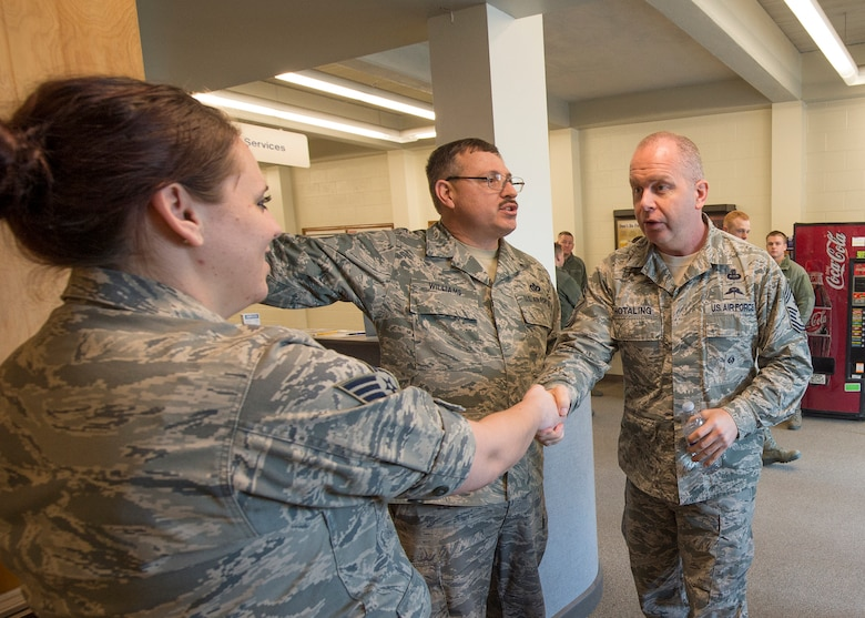 Command Chief Master Sergeant of the Air National Guard James W. Hotaling meets Senior Airman Jordon Son, a 124th Services Flight food service specialist and other services flight Airmen during his visit to the 124th Fighter Wing at Gowen Field, Boise, Idaho, Jan. 9, 2016. (U.S. Air National Guard Photos by Tech. Sgt. Sarah Pokorney)