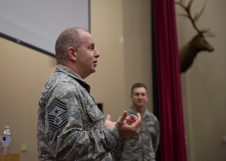 Command Chief Master Sergeant of the Air National Guard James W. Hotaling identified the newest member, Airman 1st Class Austeen A. Miller, a 124th Communications Flight cyber surety apprentice, and called him to the stage at an enlisted all during his visited the 124th Fighter Wing at Gowen Field, Boise, Idaho, Jan. 9, 2016. (U.S. Air National Guard Photos by Tech. Sgt. Sarah Pokorney)
