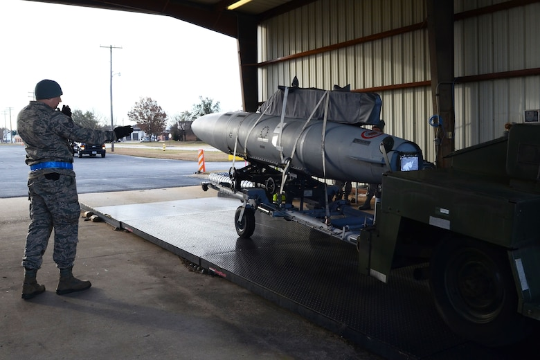 U.S. Air Force Staff Sgt. Joshua Williams, an air cargo transportation specialist assigned to the 169th Logistics Readiness Squadron, measures the weight and center balance of machine equipment during a mid-point inspection with the 169th Wing Inspection Team at McEntire Joint National Guard Base, S.C., Jan. 20, 2016. The W.I.T program ensures that all of the 169th Fighter Wing squadrons are performing procedures in accordance with the regulations mandated by the Air Combat Command. (U.S. Air National Guard photo by Senior Airman Ashleigh S. Pavelek)