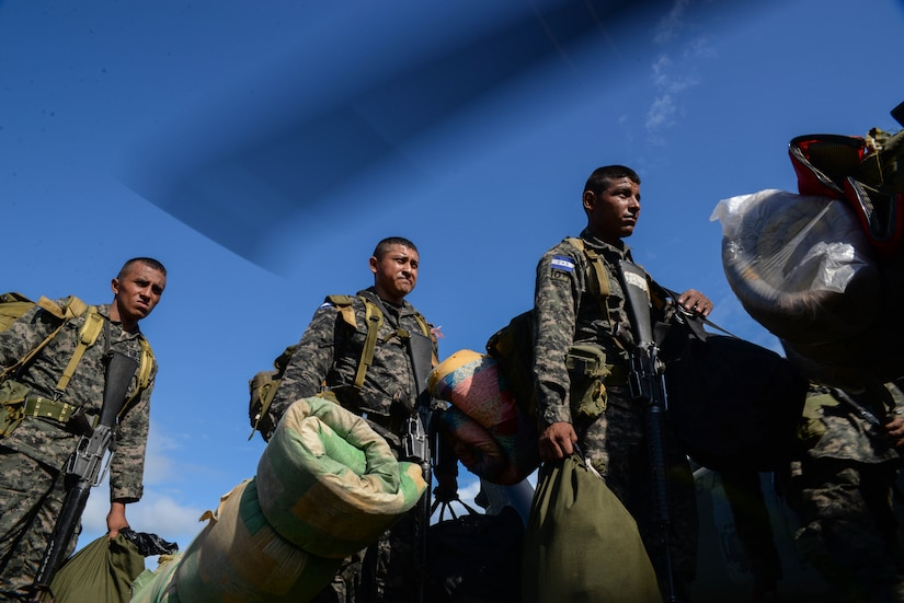 Honduran troops load on to a U.S. Army UH-60 Blackhawk helicopter during a troop rotation, in the Gracias a Dios Department (state), Honduras, Jan. 14, 2016. The rotation is part of Operation CARAVANA, in which the U.S. supports Honduras in countering the trafficking of illicit materials in the region by transporting troops via helicopter to hard to reach locations in eastern areas of the country. (U.S. Air Force photo by Senior Airman Westin Warburton/Released)