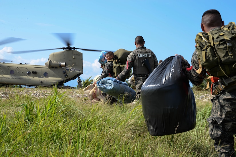Honduran troops load onto a U.S. Army CH-47 Chinook helicopter in the Gracias a Dios Department (state), Honduras, Jan. 13, 2016. The troops are part of over 5,000 Honduran soldiers the U.S. has helped transport since October 2014, to help disrupt drug trafficking in Honduras, which has been the focus of the Honduran government. (U.S. Air Force photo by Senior Airman Westin Warburton/Released)