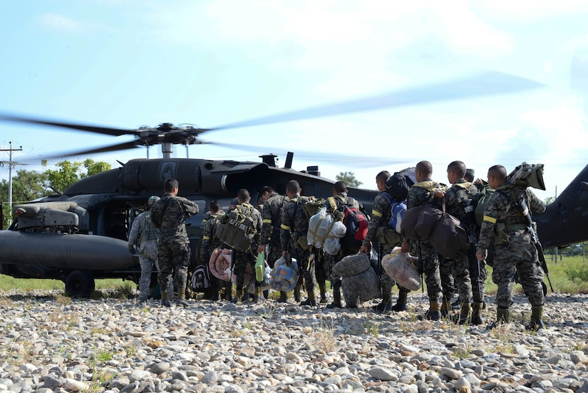 Honduran troops board a U.S. Army UH-60 Blackhawk helicopter in Gracias a Dios Department (state), Honduras, Jan. 13, 2016. The Honduran Army conducts troops in the area to disrupt drug trafficking throughout Honduras and ultimately the greater drug trafficking network in Central America. (U.S. Air Force photo by Senior Airman Westin Warburton/Released)