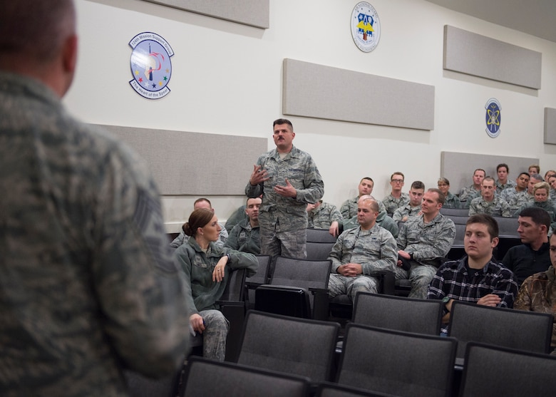 Command Chief Master Sergeant of the Air National Guard James W. Hotaling fields a question from Staff Sgt. Dean Barney, a 124th Aircraft Maintenance Squadron aircraft electrical and environmental systems specialist, during visits the 124th Fighter Wing at Gowen Field, Boise, Idaho, Jan. 9, 2016. Chief Master Sgt. James W. Hotaling took time during the visit to speak with 124th Fighter Wing's junior enlisted Airmen during an enlisted all call. (U.S. Air National Guard Photos by Tech. Sgt. Sarah Pokorney)