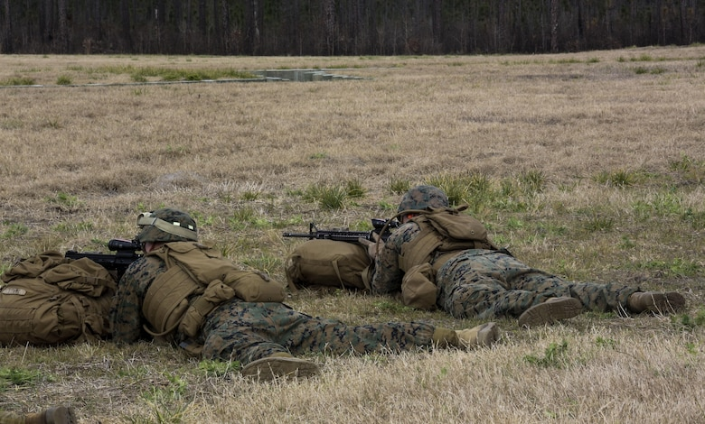 Marines with Fox Company, 2nd Battalion, 8th Marine Regiment, assault targets down range during a field exercise at Camp Lejeune, N.C., Jan. 28, 2016. Marines focused on individual marksmanship in preparation for a squad attack. (U.S. Marine Corps photo by Cpl. Paul S. Martinez/Released)