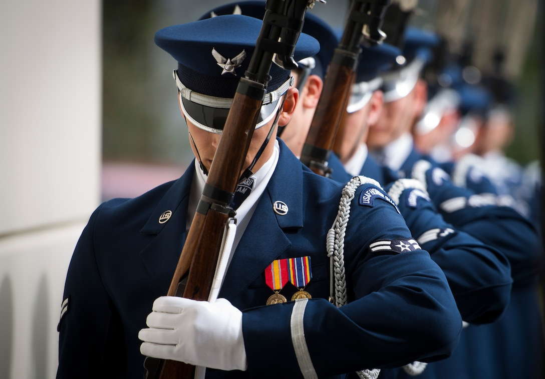Members of the United States Air Force Honor Guard drill team march in to the gymnasium at Oak Ridge High School, Orlando, Fla. Jan. 21, 2016. The Drill Team performed in front of hundreds of students and afterward held a training session with the Junior Reserve Officer Training Corps cadets. (U.S. Air Force photo by Staff Sgt. Chad C. Strohmeyer/Released)