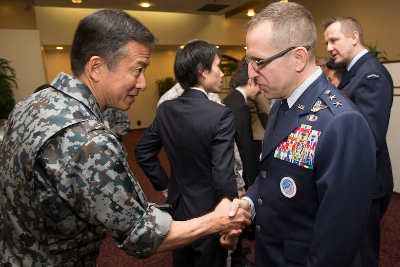 (Left to right) Japan Air Self-Defense Force Lt. Gen. Hiroaki Fukue, JASDF Air Defense Command commander, greets U.S. Air Force Maj. Gen. James Slife, deputy chief of staff for United Nations Command and U.S. Forces Korea at Yongsan Garrison, Seoul, South Korea, after the UNC (Rear) change of command ceremony at Yokota Air Base, Japan, Jan. 26, 2016. As the United Nations Command's principal representative in Japan, the UNC (Rear) maintains the status of forces agreement regarding United Nations Forces in Japan during armistice conditions. (U.S. Air Force photo by Osakabe Yasuo/Released)