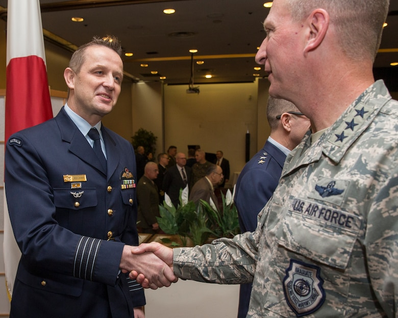 (Right to left) U.S. Air Force Lt. Gen. John Dolan, the commander of U.S. Forces Japan and the 5th Air Force, greets Royal Australian Air Force Group Captain Michael Jansen, United Nations Command (Rear) commander, after the UNC (Rear) change of command ceremony at Yokota Air Base, Japan, Jan. 26, 2016. As the United Nations Command's principal representative in Japan, the UNC (Rear) maintains the status of forces agreement regarding United Nations Forces in Japan during armistice conditions. (U.S. Air Force photo by Osakabe Yasuo/Released)