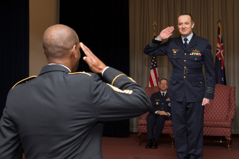 Royal Australian Air Force Group Captain Michael Jansen, United Nations Command (Rear) commander, renders his first salute as commander during the UNC (Rear) change of command ceremony at Yokota Air Base, Japan, Jan. 26, 2016. Jansen assumed command from Royal Australian Air Force Group Captain Barbara Courtney. (U.S. Air Force photo by Osakabe Yasuo/Released)