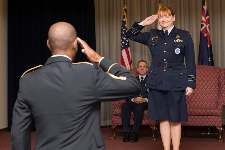 Royal Australian Air Force Group Captain Barbara Courtney, United Nations Command (Rear) commander, renders her final salute as commander during the UNC (Rear) change of command ceremony at Yokota Air Base, Japan, Jan. 26, 2016. The UNC (Rear) has historically been commanded by a U.S. Army Colonel however since 2010 the command has been filled by an Australian Air Force officer with this change of command assigning the fourth successive Australian commander. (U.S. Air Force photo by Osakabe Yasuo/Released)