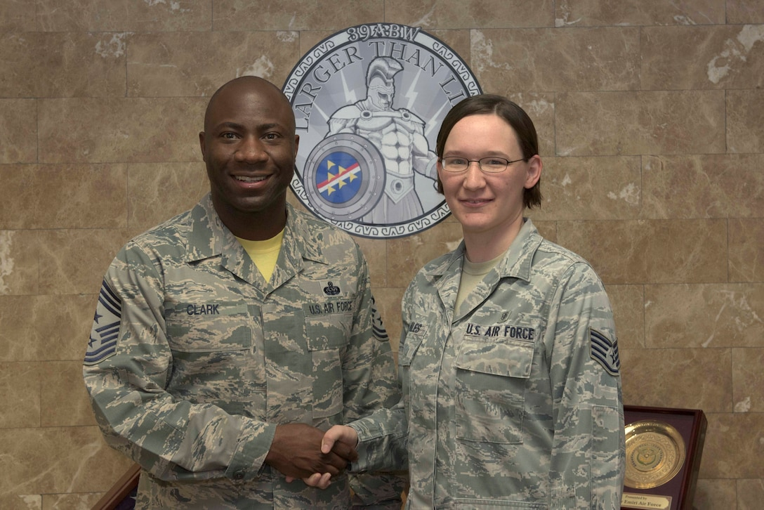 Chief Master Sgt. Vegas Clark, 39th Air Base Wing command chief, stands for a photo with Staff Sgt. Kathryn Hiles, 39th Medical Support Squadron medical laboratory technician before beginning Hiles' chief shadow day on June 29, 2016. Airmen are chosen for the command chief's shadow program based on their commander's recommendation and their dedication to the mission. (U.S. Air Force photo by Airman 1st Class Devin M. Rumbaugh/Released)
