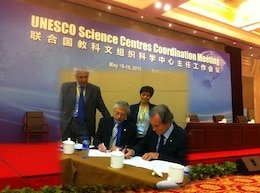 Professor Maciej Zalewski (seated, right), Director, ERCE, Polish Academy of Sciences (Poland), and Robert Pietrowsky (seated, left), Director, USACE IWR & ICIWaRM, under the auspices of UNESCO (USA), signing a MOU in Beijing China on 17 May 2016, with Dr. Blanca Jimenez-Cisneros,  Director, UNESCO Division of Water Sciences and Secretary, International Hydrological Programme (standing, right) and Giuseppe Arduino, Chief, Ecohydrology, Water Quality & Water Education Section, IHP Secretariat (standing, left).