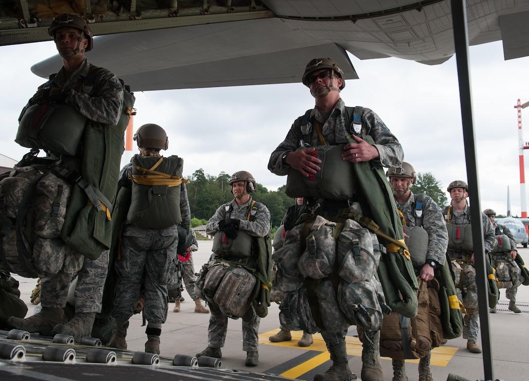 Airmen from the 2nd Air Support Operations Squadron board a C-130J Super Hercules to participate in a Joint Airborne Air Transportability Training exercise with the 37th Airlift Squadron June 30, 2016, at Ramstein Air Base, Germany. The exercise allowed the Airmen to test their abilities in flying to a location and successfully jumping out and landing in a designated area, to prepare for future real-world scenarios. (U.S. Air force photo/Airman 1st Class Lane T. Plummer)