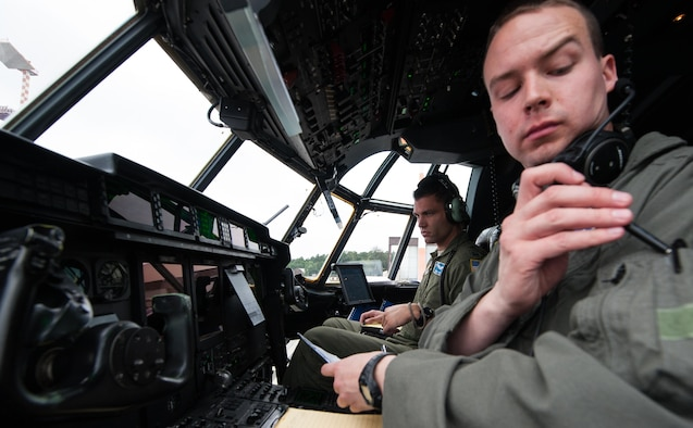 First Lt. Robert Lahr and Capt. Brian Vos, 37th Airlift Squadron pilots, prepare a C-130J Super Hercules for take-off during a Joint Airborne Air Transportability Training exercise June 30, 2016, at Ramstein Air Base, Germany. The 37th AS maintains mission readiness by integrating JA/ATT training alongside other units such as the 2nd Air Support Operations Squadron. (U.S. Air force photo/Airman 1st Class Lane T. Plummer)