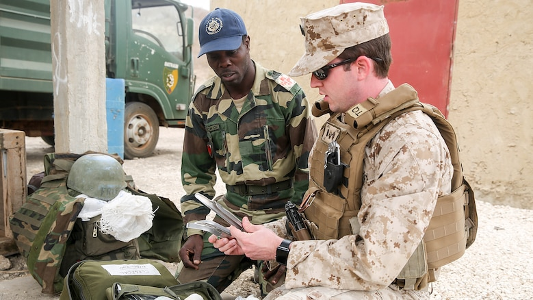 Lt. j.g. David Lane, a physician assistant with Special Purpose Marine Air-Ground Task Force Crisis Response-Africa, demonstrates appropriate use of medical equipment to medical personnel from the Compagnie Fusilier de Marin Commando in Thies, Senegal, June 22 2016. Marines and the COFUMACO conducted a three-week training exercise that included advanced combat firing techniques, a machine gun range and a live-fire platoon attack range.