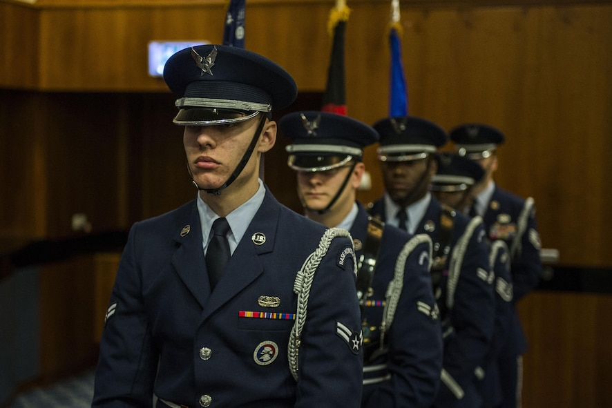 A Spangdahlem Air Base ceremonial guardsmen detail present the colors during the 52nd Communications Squadron change of command ceremony at the Brickhouse on Spangdahlem Air Base, Germany, June 29, 2016. It is tradition for the guardsmen to post both the United States and the host nation's flags depending on where they are stationed. (U.S. Air Force photo by Senior Airman Luke Kitterman/Released)