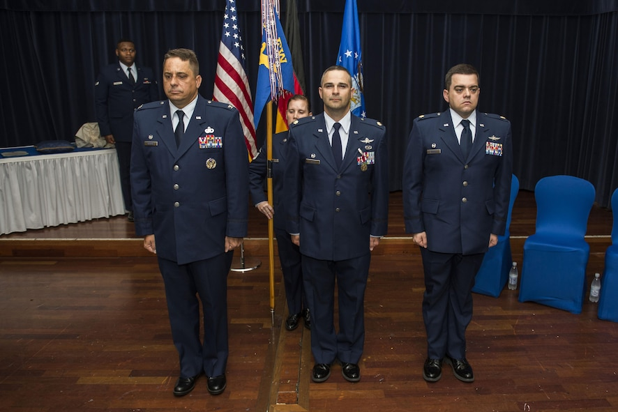 U.S. Air Force Col. Steven Zubowicz, 52nd Mission Support Group commander, left, U.S. Air Force Maj. Duane Fisher, former 52nd Communications Squadron commander, center, and U.S. Air Force Maj. Christopher Waddell, 52nd CS commander, right, stand at attention during the 52nd CS change of command ceremony in the Club Eifel Ballroom at Spangdahlem Air Base, Germany, July 1, 2016. Zubowicz was the presiding officer for ceremony and exchanged command of the 52nd CS from Fisher to Waddell. (U.S. Air Force photo by Senior Airman Luke Kitterman/Released)