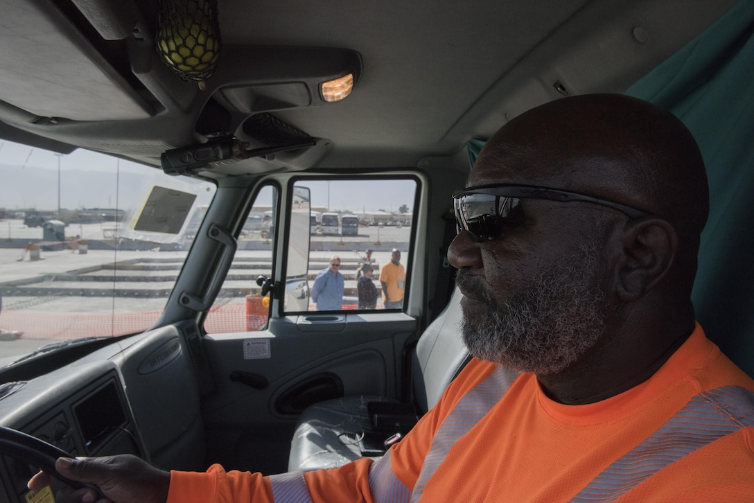 Darrel Gibbs, heavy truck driver, responds to an airfield construction site, July 1, 2016, Bagram Airfield, Afghanistan. Gibbs drives a ground sweeper and helps ensure that all foreign object debris such as rocks are cleared from the airfield while construction is going on. (U.S. Air Force photo by Tech. Sgt. Tyrona Lawson)