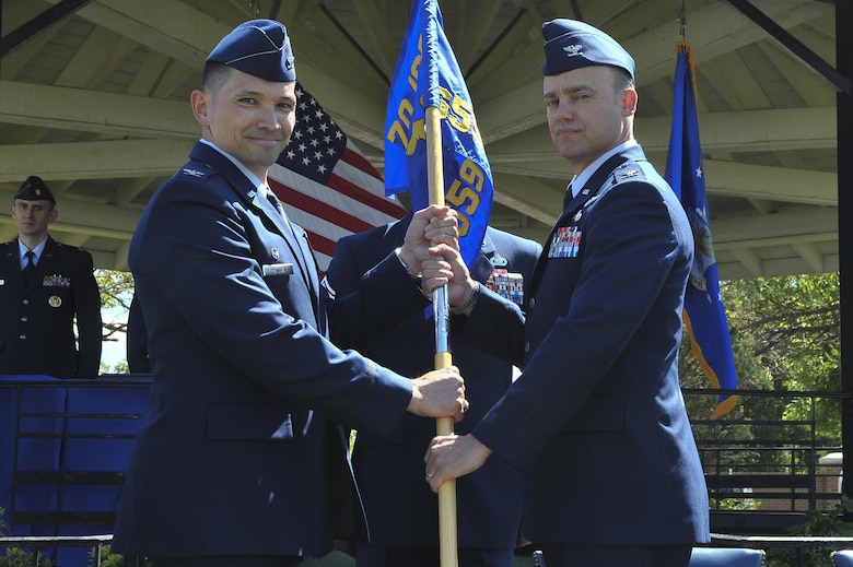 Col. Thomas Hensley, 70th Intelligence, Surveillance and Reconnaissance Wing commander, passes the guidon to Col. Aaron Drake, 659th Intelligence, Surveillance and Reconnaissance Group commander, during the 659th ISRG change of command ceremony June 29, 2016, at Fort George G. Meade, Md. The 659th ISRG conducts global integrated cyber ISR operations with Air Force, Joint, and Intelligence Community partners to detect, characterize, and mitigate cyber threats, exploit computer networks and enable full-spectrum cyberspace operations. (U.S. Air Force photo/Staff Sgt. Alexandre Montes)