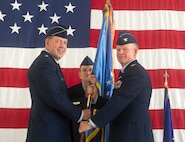 Col. Darrell Judy, right, accepts the guidon and command, of the 71st Flying Training Wing from Maj. Gen. James Hecker, the 19th Air Force commander, during a change-of-command ceremony June 28 at Vance Air Force Base, Oklahoma. Judy replaced Col. Clark Quinn. (U.S. Air Force photo/ Terry Wasson)