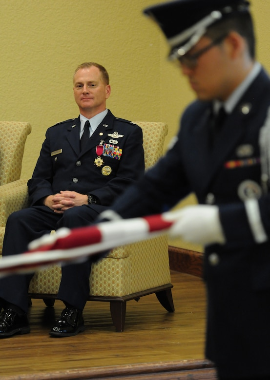 Col. Dennis Scarborough, 81st Training Wing vice commander, watches as the Keesler Honor Guard folds the U.S. flag during his retirement ceremony at the Bay Breeze Event Center June 28, 2016, on Keesler Air Force Base, Miss. Scarborough retired with 27 years of military service. He has served multiple tours as an F-15C instructor and evaluator and has held positions in the fields of defense policy, operational plans, safety and aircraft maintenance. He has commanded at the squadron level and served as an operations group deputy commander. (U.S. Air Force photo by Kemberly Groue/Released)