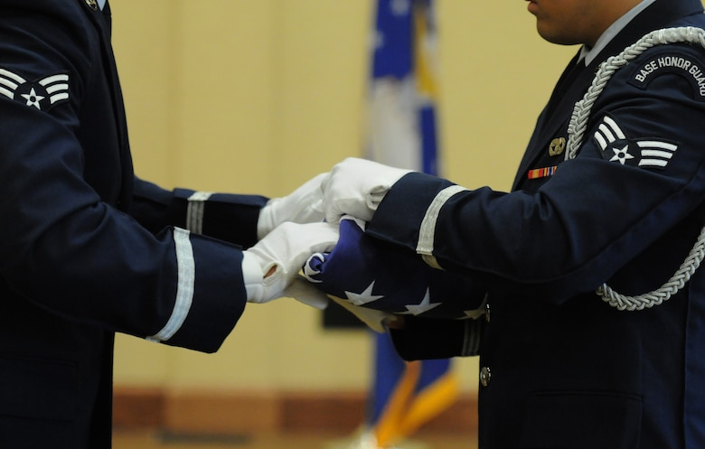 The Keesler Honor Guard folds the U.S. flag during the retirement ceremony for Col. Dennis Scarborough, 81st Training Wing vice commander, at the Bay Breeze Event Center June 28, 2016, on Keesler Air Force Base, Miss. Scarborough retired with 27 years of military service. He has served multiple tours as an F-15C instructor and evaluator and has held positions in the fields of defense policy, operational plans, safety and aircraft maintenance. He has commanded at the squadron level and served as an operations group deputy commander. (U.S. Air Force photo by Kemberly Groue/Released)