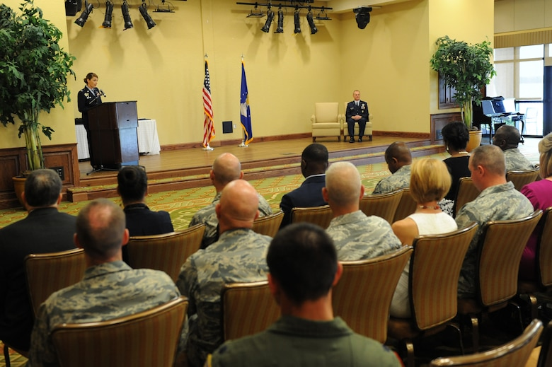 Col. Michele Edmondson, 81st Training Wing commander, delivers remarks during the retirement ceremony for Col. Dennis Scarborough, 81st TRW vice commander, at the Bay Breeze Event Center June 28, 2016, on Keesler Air Force Base, Miss. Scarborough retired with 27 years of military service. He has served multiple tours as an F-15C instructor and evaluator and has held positions in the fields of defense policy, operational plans, safety and aircraft maintenance. He has commanded at the squadron level and served as an operations group deputy commander. (U.S. Air Force photo by Kemberly Groue/Released)
