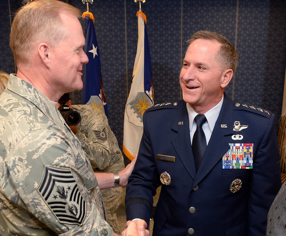 Chief Master Sgt. of the Air Force James A. Cody congratulates Air Force Chief of Staff Gen. David L. Goldfein after the general was sworn in during a ceremony at the Pentagon in Washington, D.C., June 1, 2016. Goldfein became the 21st chief of staff of the Air Force. (U.S. Air Force photo/Andy Morataya)