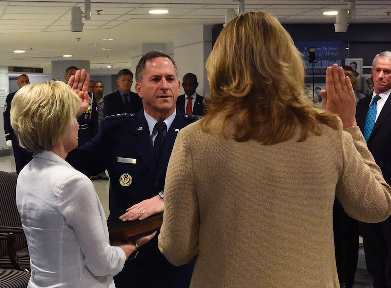 Air Force Chief of Staff Gen. David L. Goldfein takes the oath of office as his wife, Dawn, holds the chief of staff Bible during a swearing-in ceremony at the Pentagon in Washington, D.C., June 1, 2016. Goldfein became the 21st chief of staff of the Air Force. (U.S. Air Force photo/Tech Sgt. Dan DeCook)